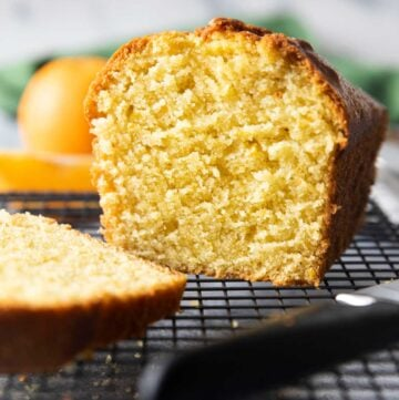 A closer shot of the inside of orange pound cake, highlighting the texture of the cake.