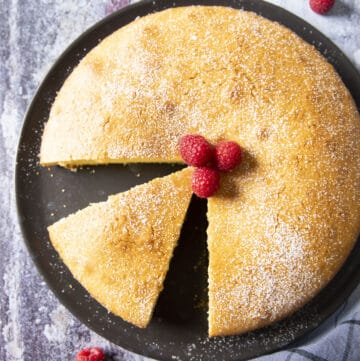 An overhead shot of a delicious olive oil cake, dusted with powdered sugar.