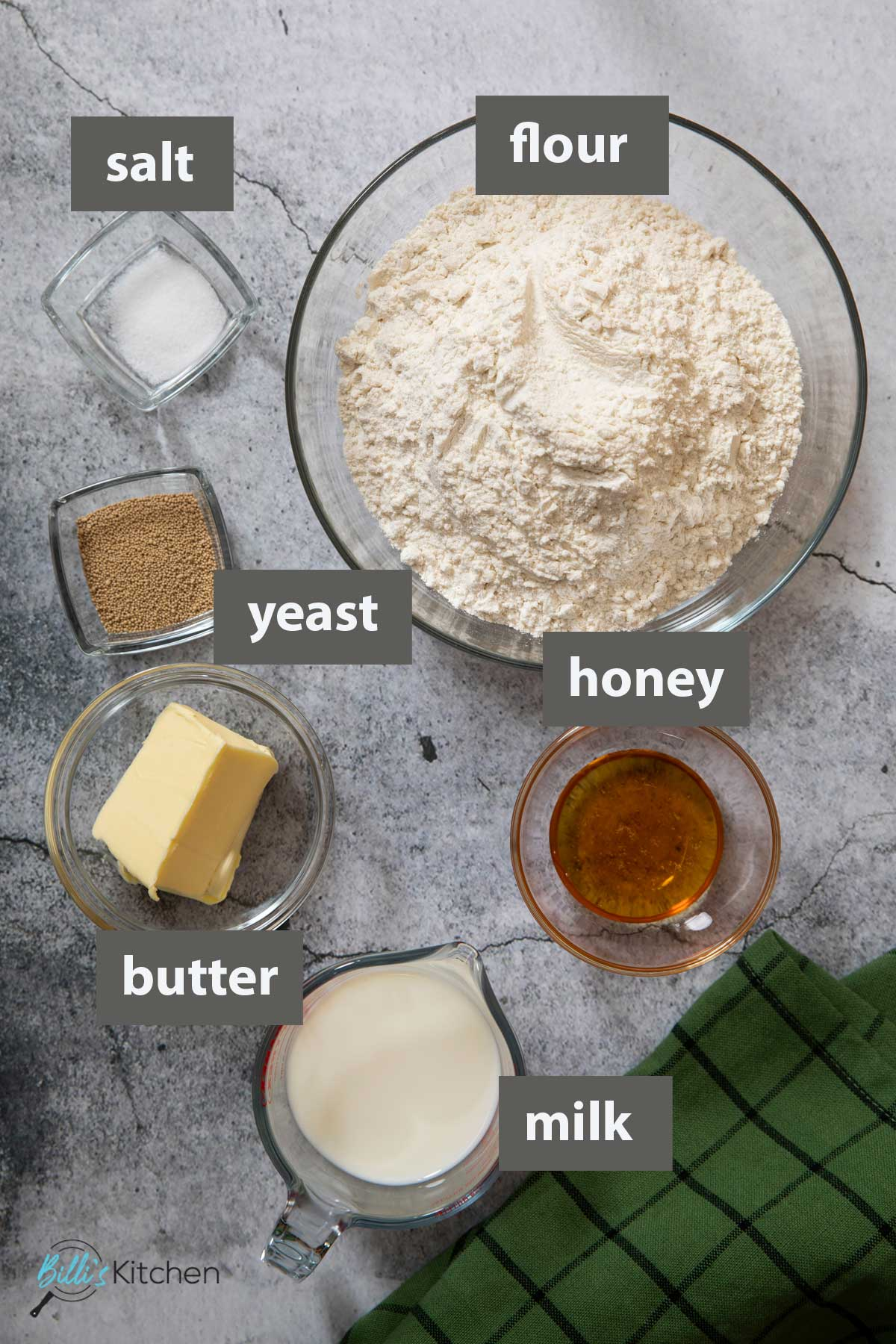 An image showing all the ingredients you need to make sandwich bread at home.