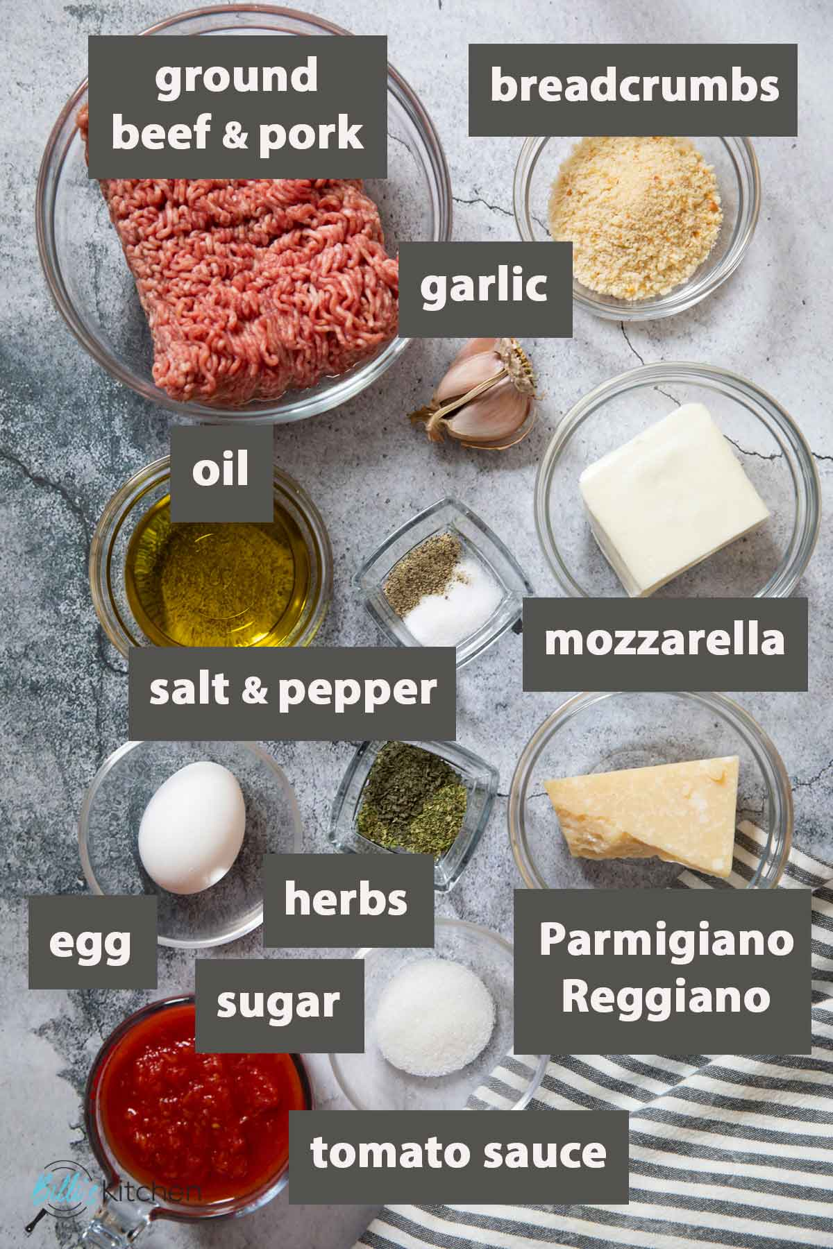 An image showing all the ingredients you need to prepare baked meatballs in tomato sauce.