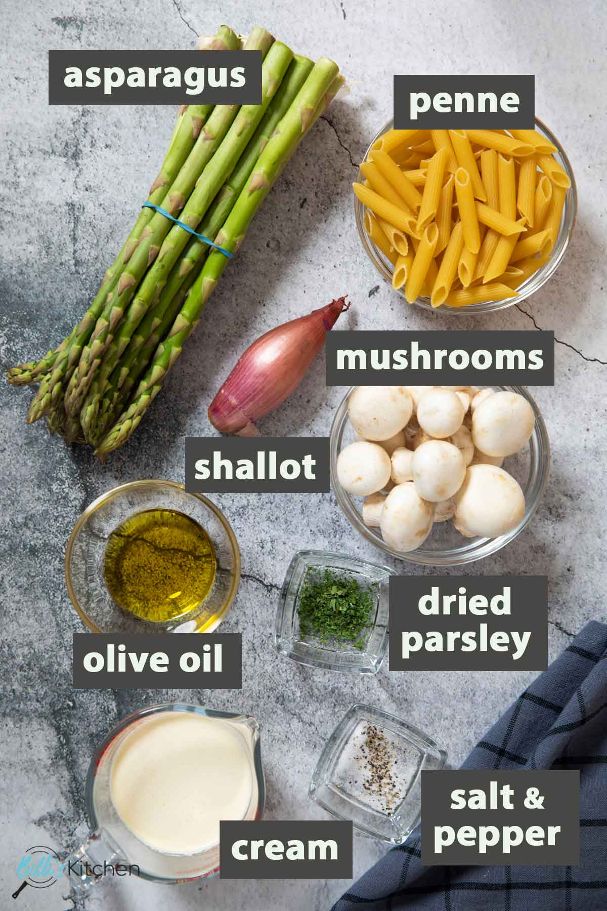 An image showing all the ingredients you need to prepare mushroom asparagus pasta.