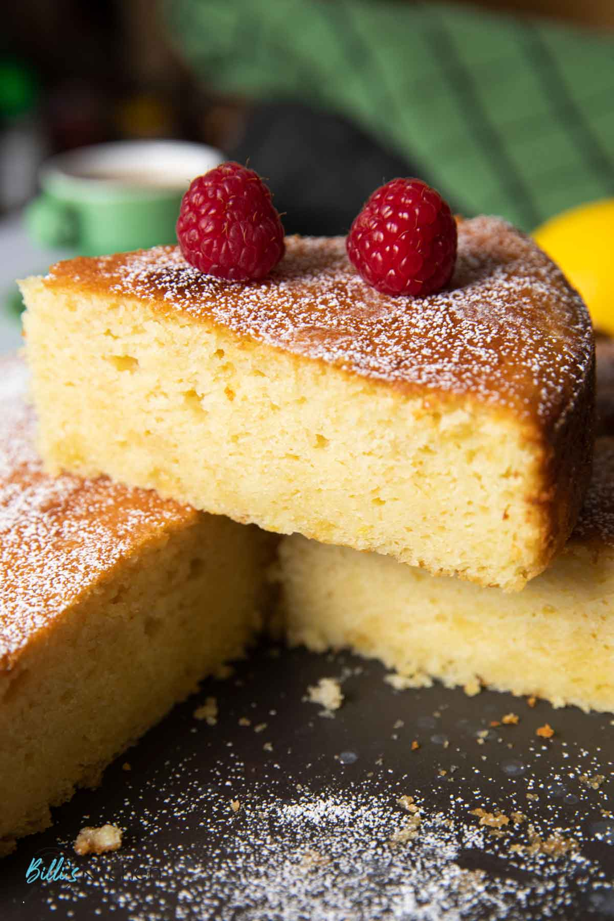 A closer shot of a slice of lemon ricotta cake, highlighting the texture of the cake.