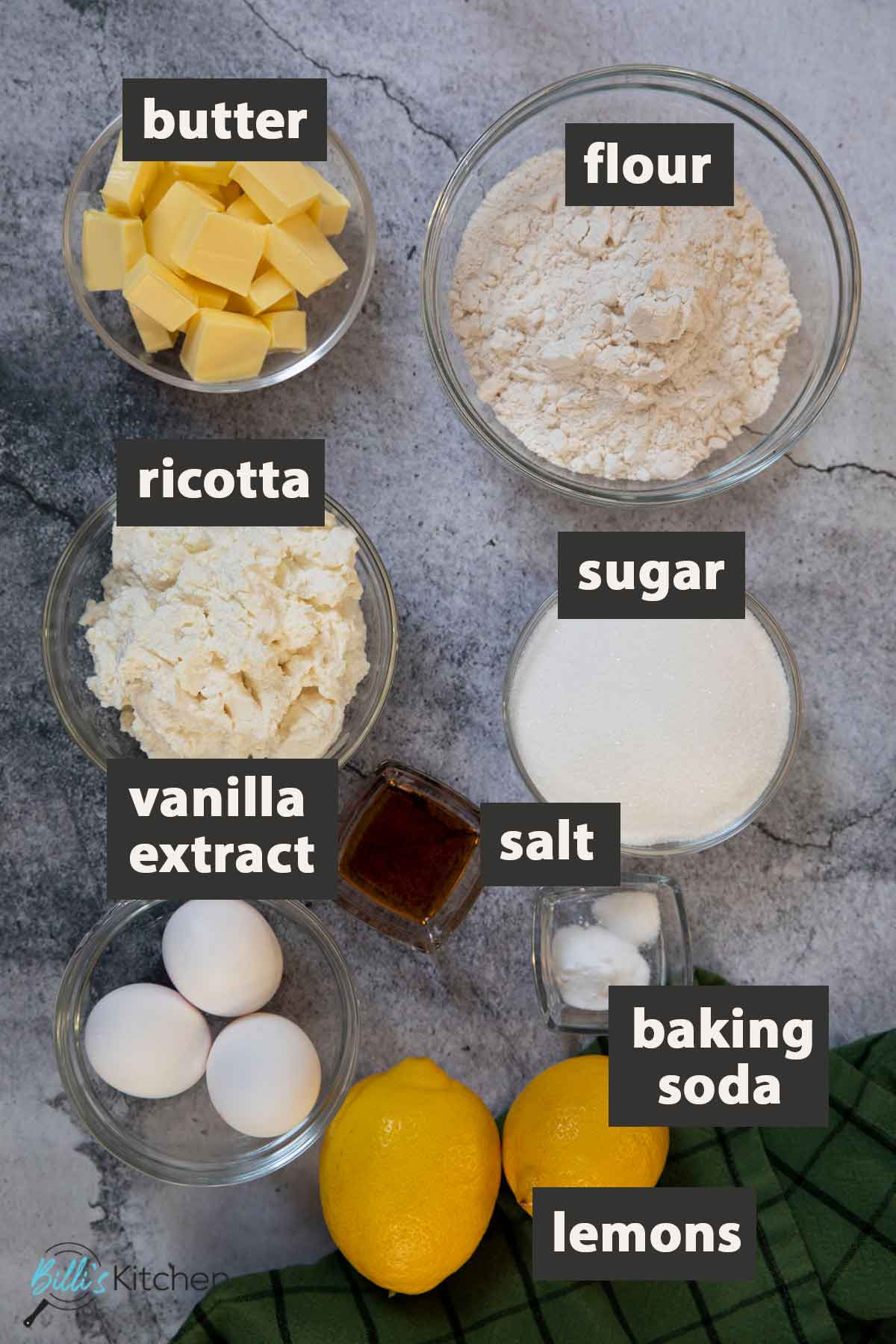 An image showing all the ingredients you need to prepare easy lemon ricotta cake.
