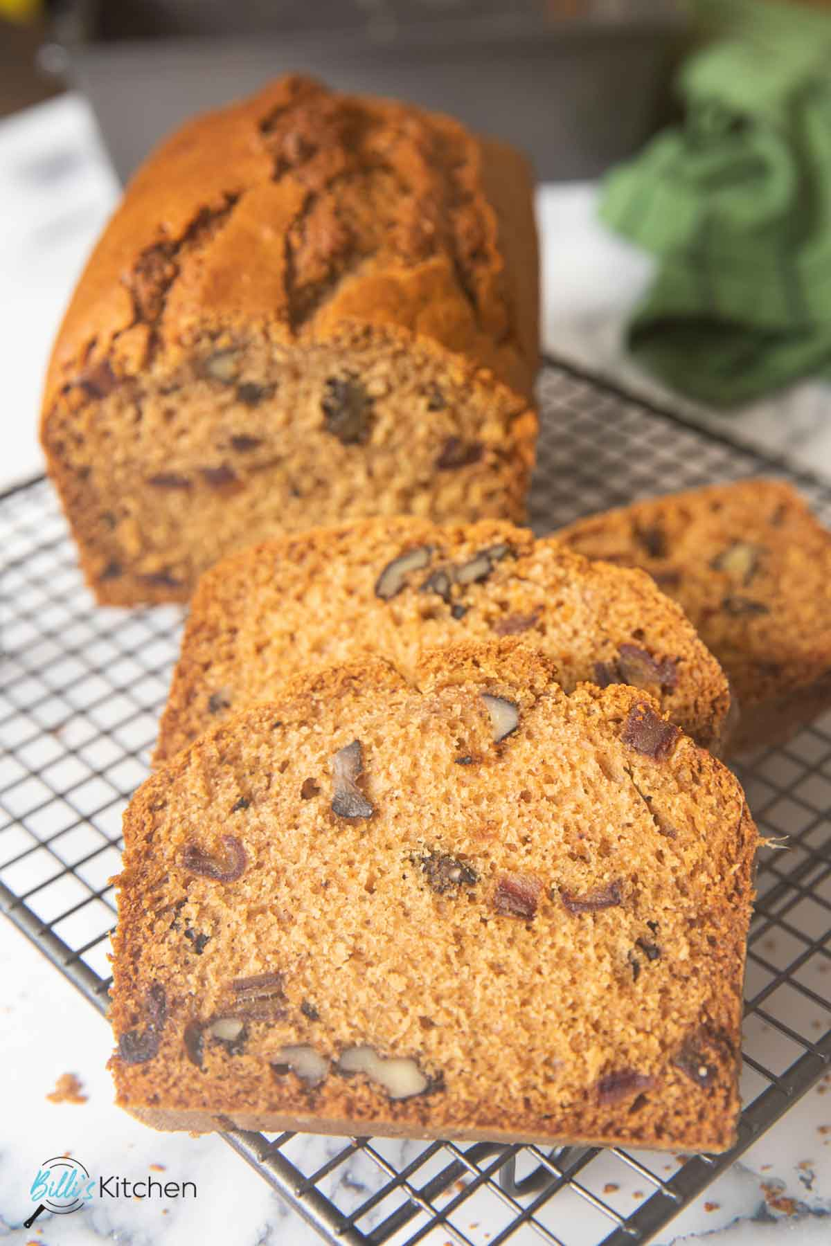 A closer shot of a slice of date nut bread highlighting the texture of the bread.
