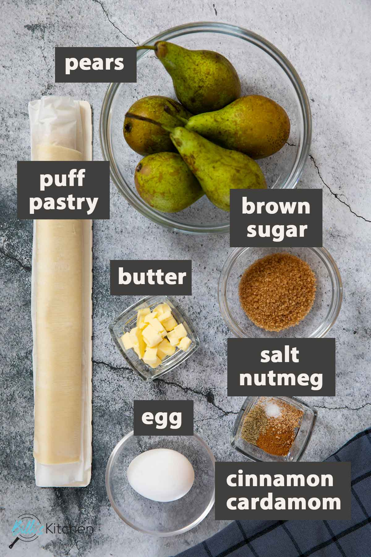 An image showing all the ingredients you need to prepare pear tart with puff pastry at home.