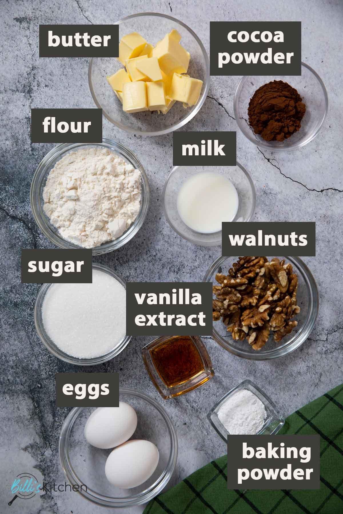 An image showing all the ingredients you need to prepare chocolate walnut butter cake at home.